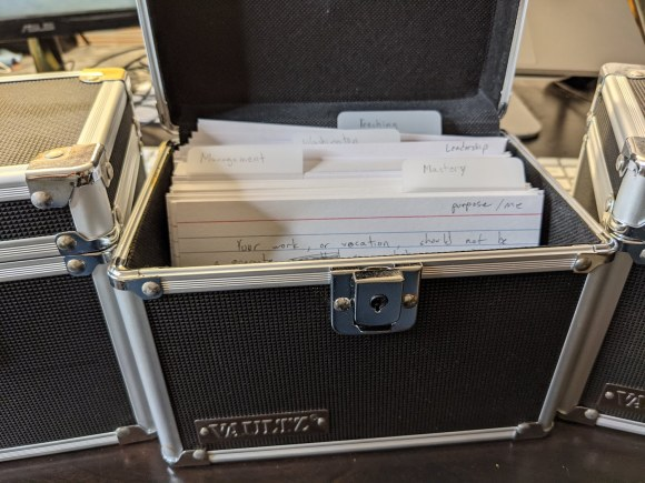 Notecards organized in a storage container.