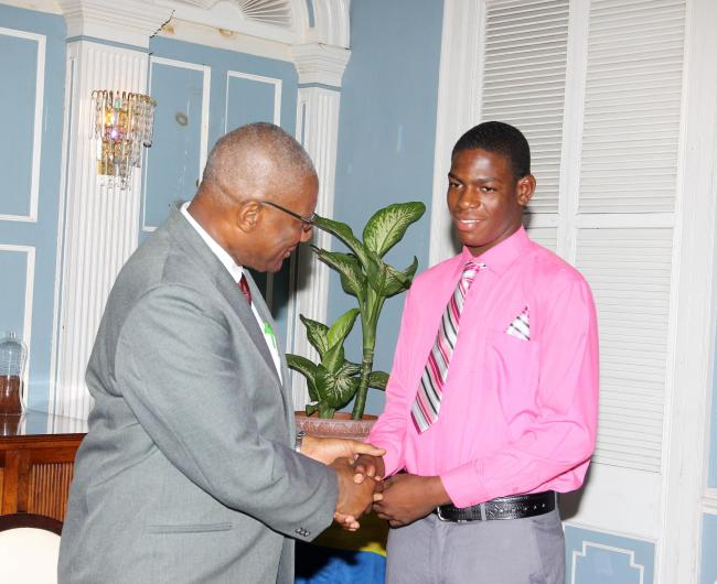 His Excellency Sir Rodney Williams being greeted by a resident of the Boy's Training School