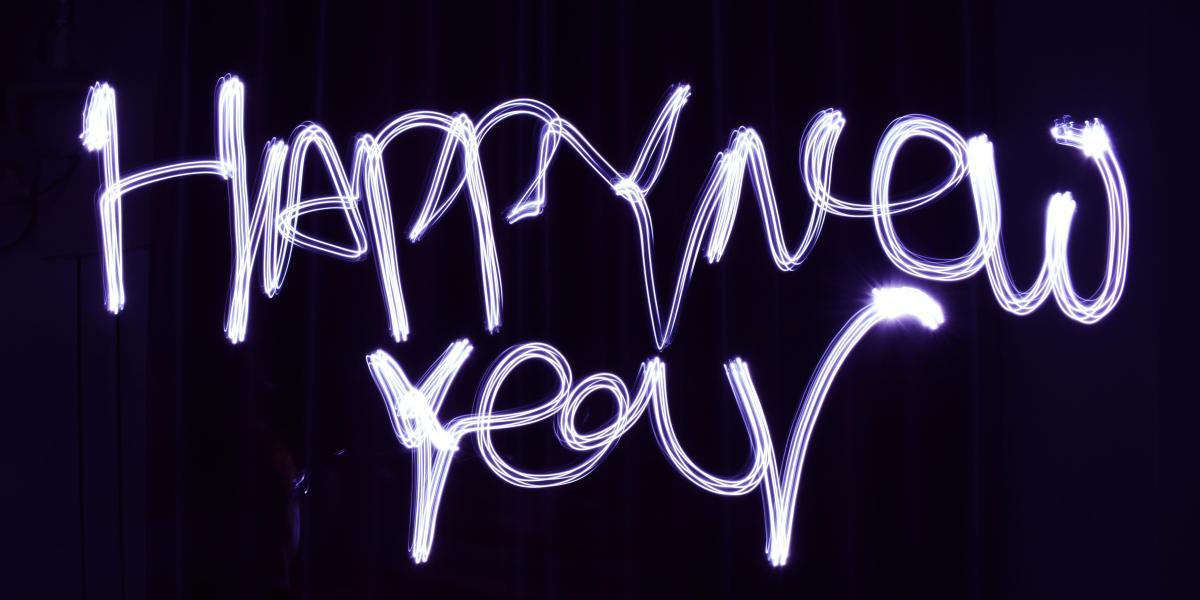 Happy New Year written in illuminating sparklers