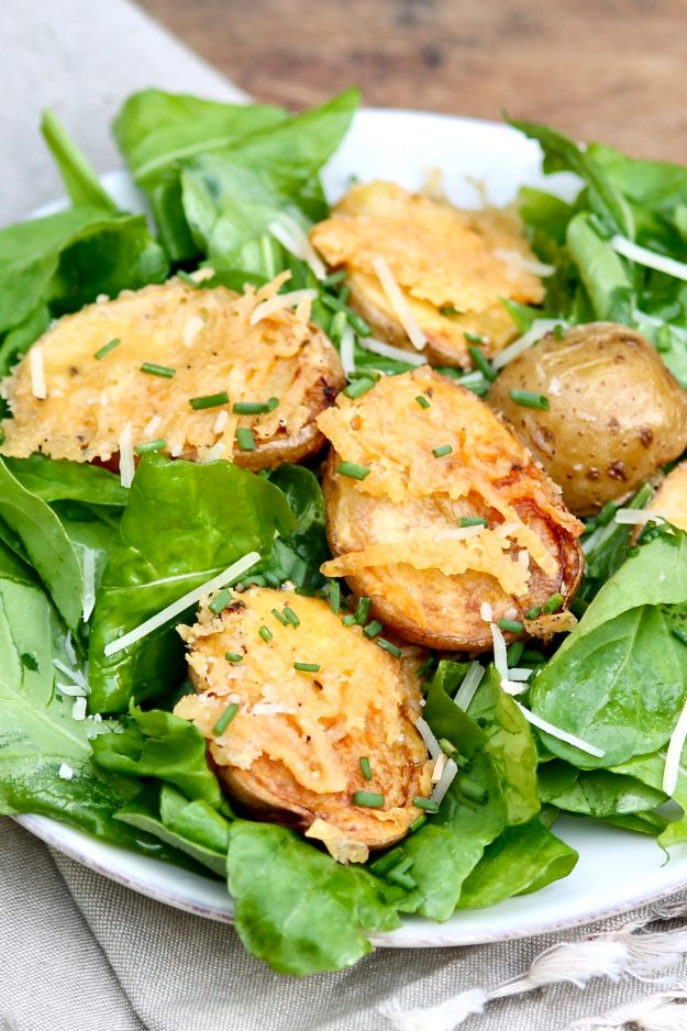 A golden crust that complements the creamy potatoes is the magic that happens when a clever baking method meets a little bit of olive oil and Parmesan cheese.And they taste great in a salad!