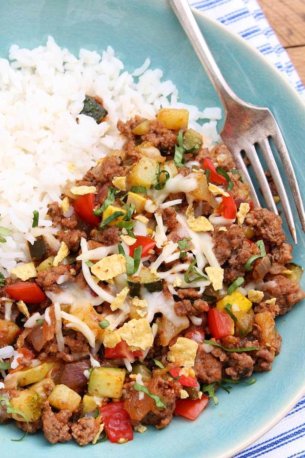 Easy Zucchini and Ground Beef Dinner -- Six basic ingredients form the foundation of this adaptable one-skillet meal, which comes together quickly for a family-friendly dinner on even the busiest of weeknights.