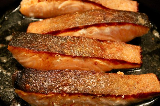 Crispy Skin Salmon -- A quick sear on the stovetop creates tender salmon with deliciously crispy skin... perfect with your favorite seasonal side dishes or as a salad topper!