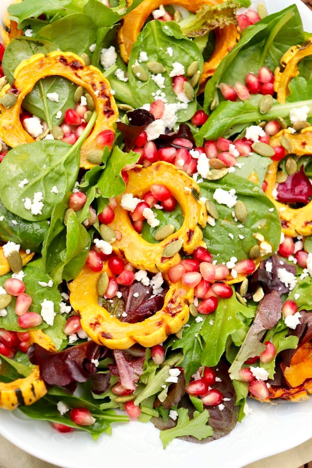 Radiant jewel tones make this versatile salad stunning AND healthy. Feel free tosubstitute any winter squash (even sweet potatoes) or use cranberries in place of pomegranate!