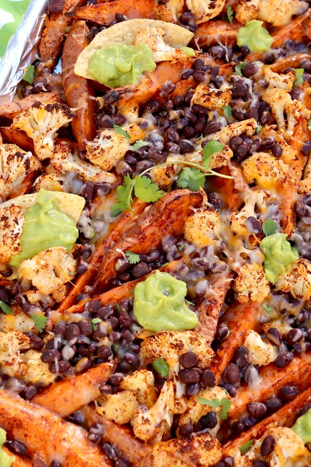 """Roasted Veggie """"Nachos"""" are a healthy, super satisfying spin on the typical appetizer that can becustomized to taste and enjoyed as a filling, plant-based meal. Can be prepared on a single sheet pan, too!"""