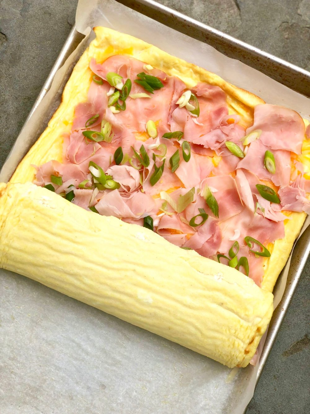 Omelet Roll-Perfect for holidays, special brunches and breakfast for dinner, this festive roll offers a fuss-free alternative to making omelets for a crowd.