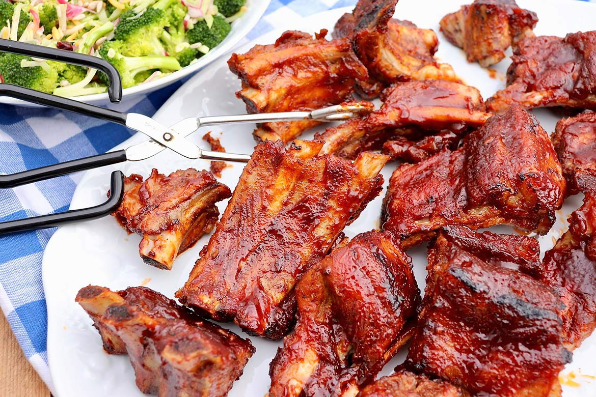 Oven Baked BBQ Ribs-Melt-in-your mouth ribs with crispy edges are a breeze to prepare with this easy recipe. No need to tend the grill for hours and perfect any time of year!