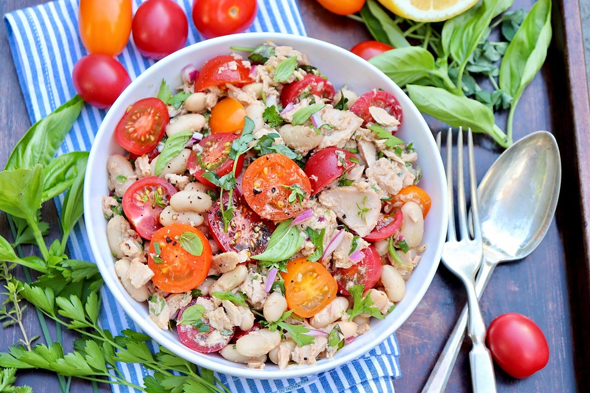 Tuna, Tomato & White Bean Salad-Pantry staples meet sweet tomatoes and a handful of fresh herbs in this protein-rich, flavor-packed salad. Enjoy it as an easy lunch or pair with an ear of corn, piece of cornbread or a crusty roll for a light but filling dinner. (Leftovers taste great, too!)