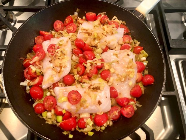 BRAISED COD with TOMATOES and LEEKS - Once the veggies are chopped, this one-pan fish dish cooks in 15 minutes and is loaded with flavor. Elegant enough for company yet simple enough for busy weeknights, it's also a delicious way to increase your intake of heart-healthy fish.