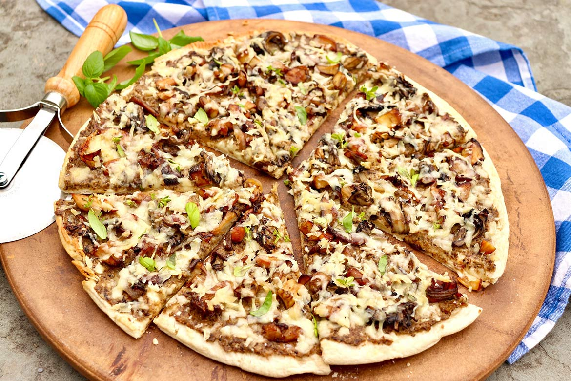 "The flavor-packed ""sauce"" and topping of this unconventional pizza can be prepared in advance so the pizza can be simply assembled and baked when ready to eat. Even those who dislike mushrooms have fought over the last slice!"
