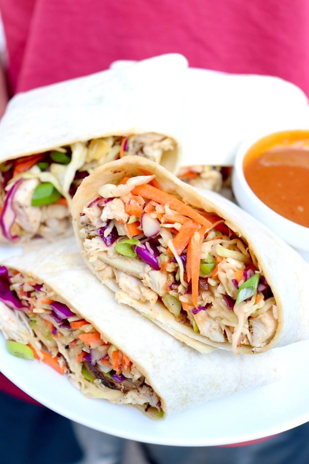 Crunchy slaw and protein-rich chicken are bathed in a peanutty dressing then rolled into a handy wrap in this Asian-inspired meal that is sure to become a family favorite!