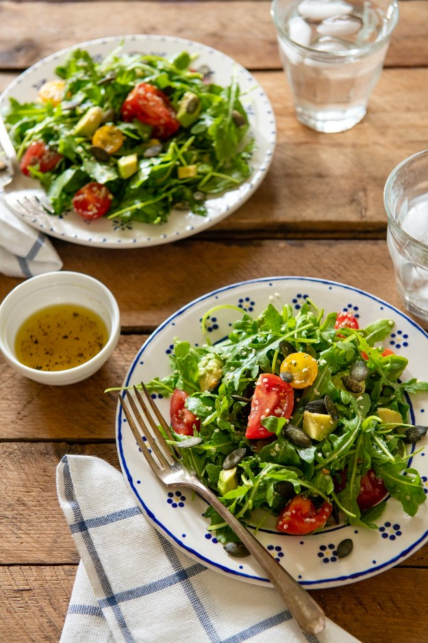 The simplest of vinaigrettes provides exceptional flavor in this crunchy, creamy, peppery, nutrient-dense salad that is so much more than the sum of its parts. The addition of your favoriteprotein will make it a complete meal.