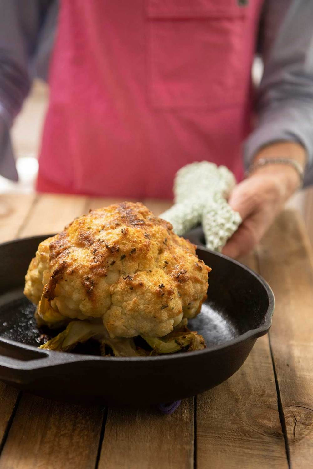 A whole roasted head of cauliflower is delicious AND impressive. It can also be easy and relatively quick thanks to a helpful shortcut!