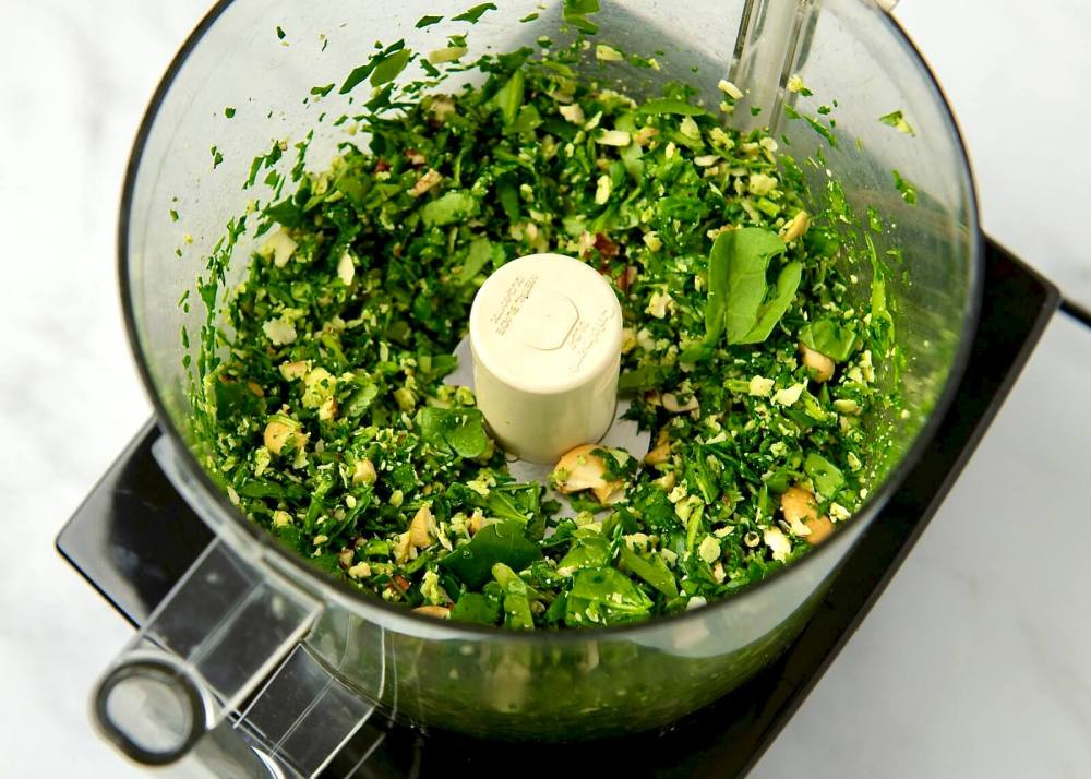 Easy, accessible, and endlessly versatile, this flavorful pesto is especially ideal when fresh herbs aren't available. Perfect for adding flavor to pasta, pizza and flatbread, sauces, sandwiches, and so much more, the simple recipe can be customized with a variety of nuts, seeds, and cheeses. Plus it maintains its vibrant green color and freezes well!