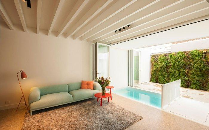 Small Indoor Pool nested in a Tiny Minimalist Belgium