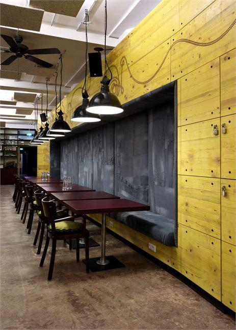 Industrial cafe interior  and yellow wall for a colorful