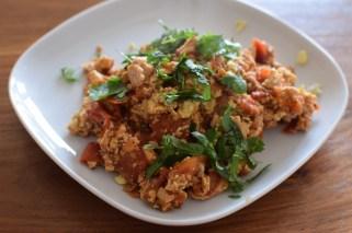 Fried tofu, scrambled egg, tomato, garnished with coriander