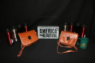 Lighted sign Mossy Oak mugs, thermus and leather purses by Colorado Cache.
