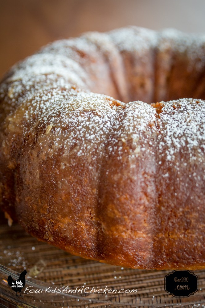 a close up of the sherry bundt cake with powdered sugar sprinkled on top