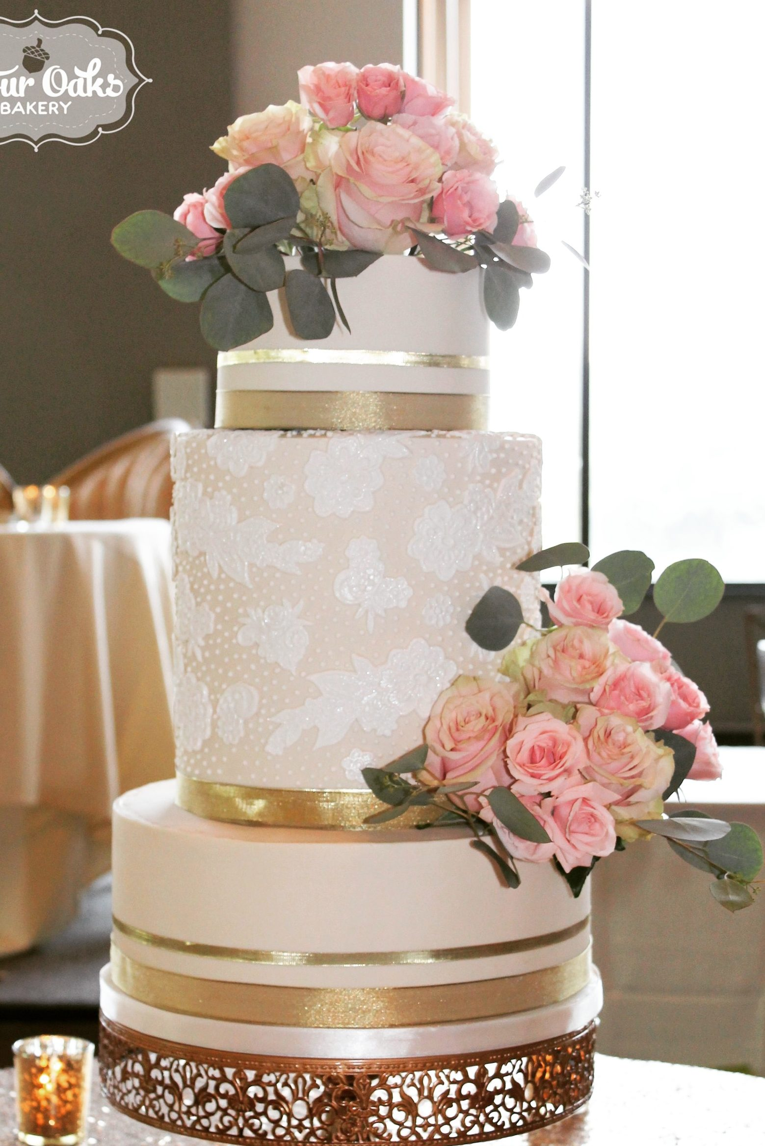 Courtney and Luke's Ivory and Gold Wedding Cake at Chestnut Ridge Resort in Blairsville, PA