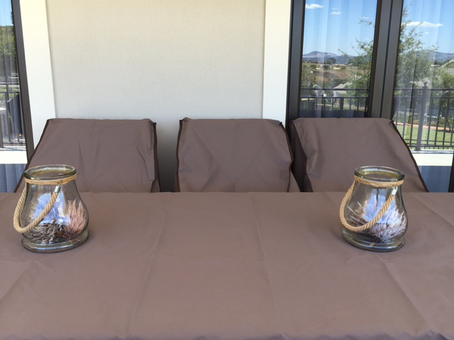 Brown table and chair covers