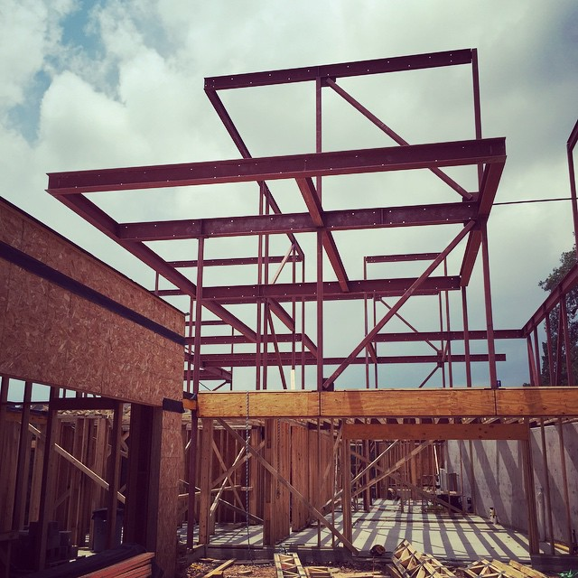 Three floors of structural steel makes anything possible with this A-Parallel Architecture design being built by Foursquare Builders.
