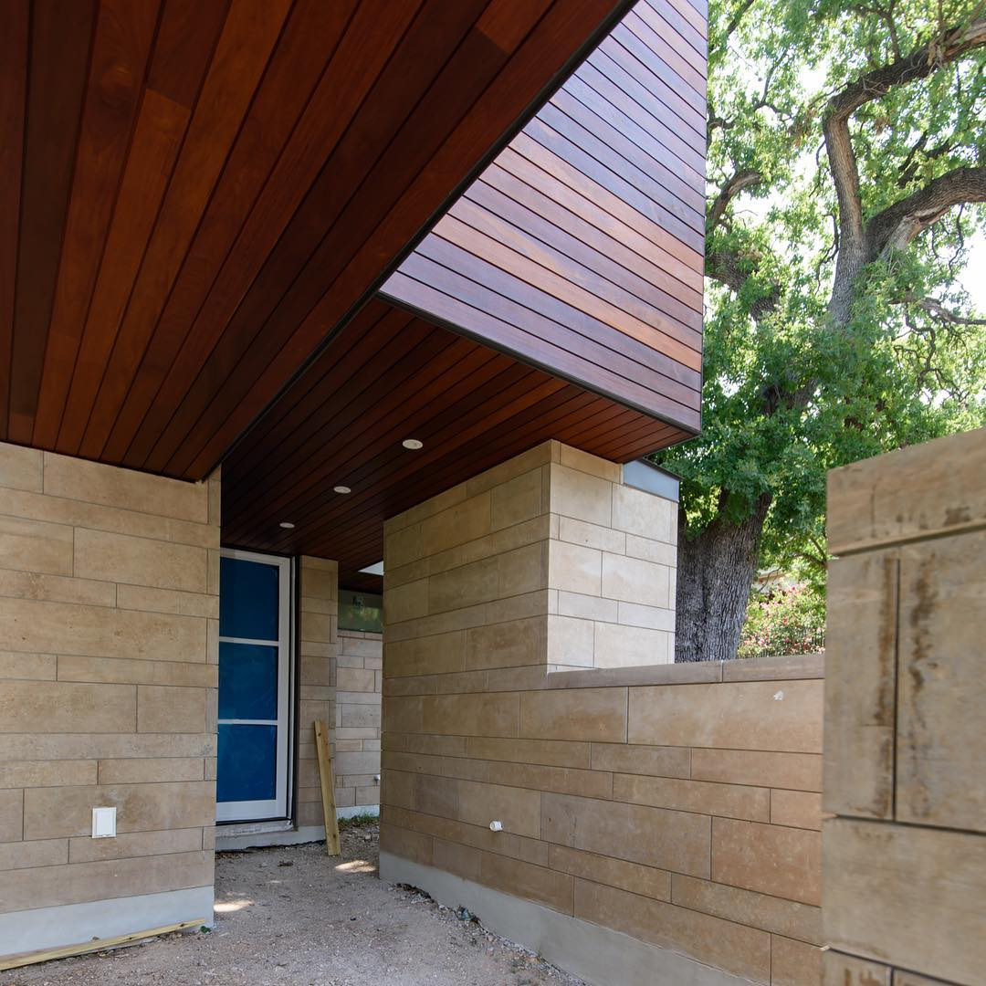 Carport entry to our Castle Hill home. Ipe Rainscreen and Cinnamon Lueders frame this back entry. Built by @foursquarebuilders Designed by @dc_architecture Photo by @redpantsstudio