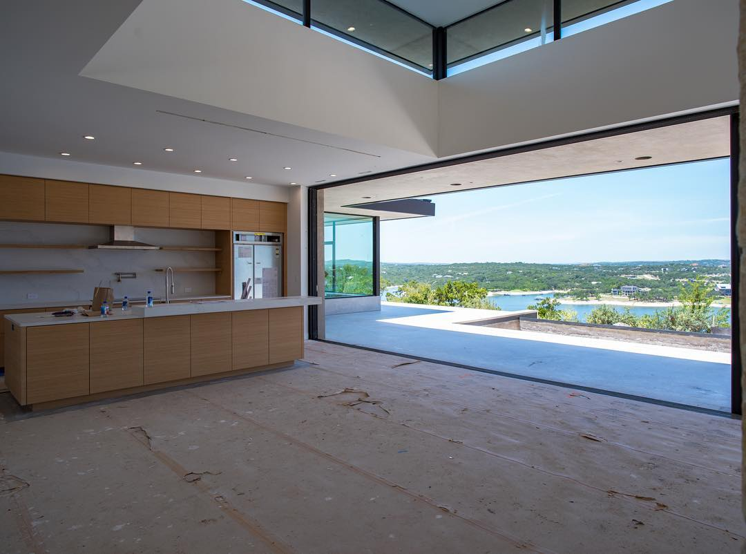 It's what everyone wants!! An open wall to the world!! Built by @foursquarebuilders Designed by @dc_architecture Photo by @redpantsstudio Sliding door by @fleetwood_windows_doors Kitchen by @flitchbyhw Countertops by @silestonebycosentino
