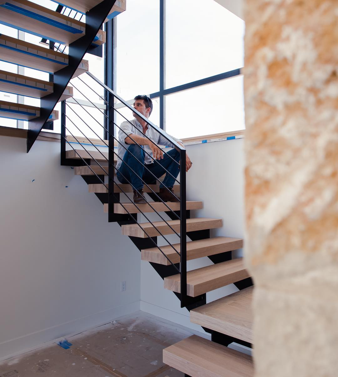 Contemplation of design with Breck Craparo on our latest stair install. Built by @foursquarebuilders & @austin_iron & @ingrainedbynature Designed by @dc_architecture Photo by @redpantsstudio