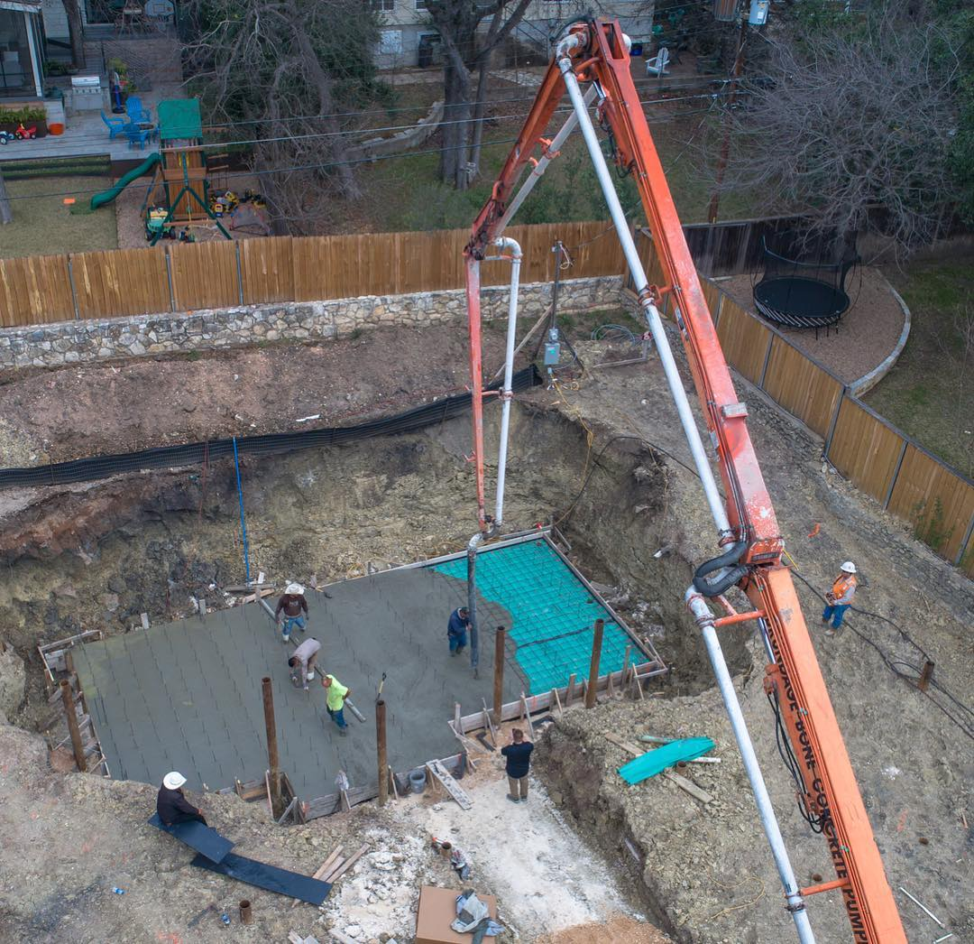 Building around bad soil. Void Form concrete foundation and piers to support the swimming pool. Designed by @lankerani_architecture Build by @foursquarebuilders Drone by @redpantsstudio