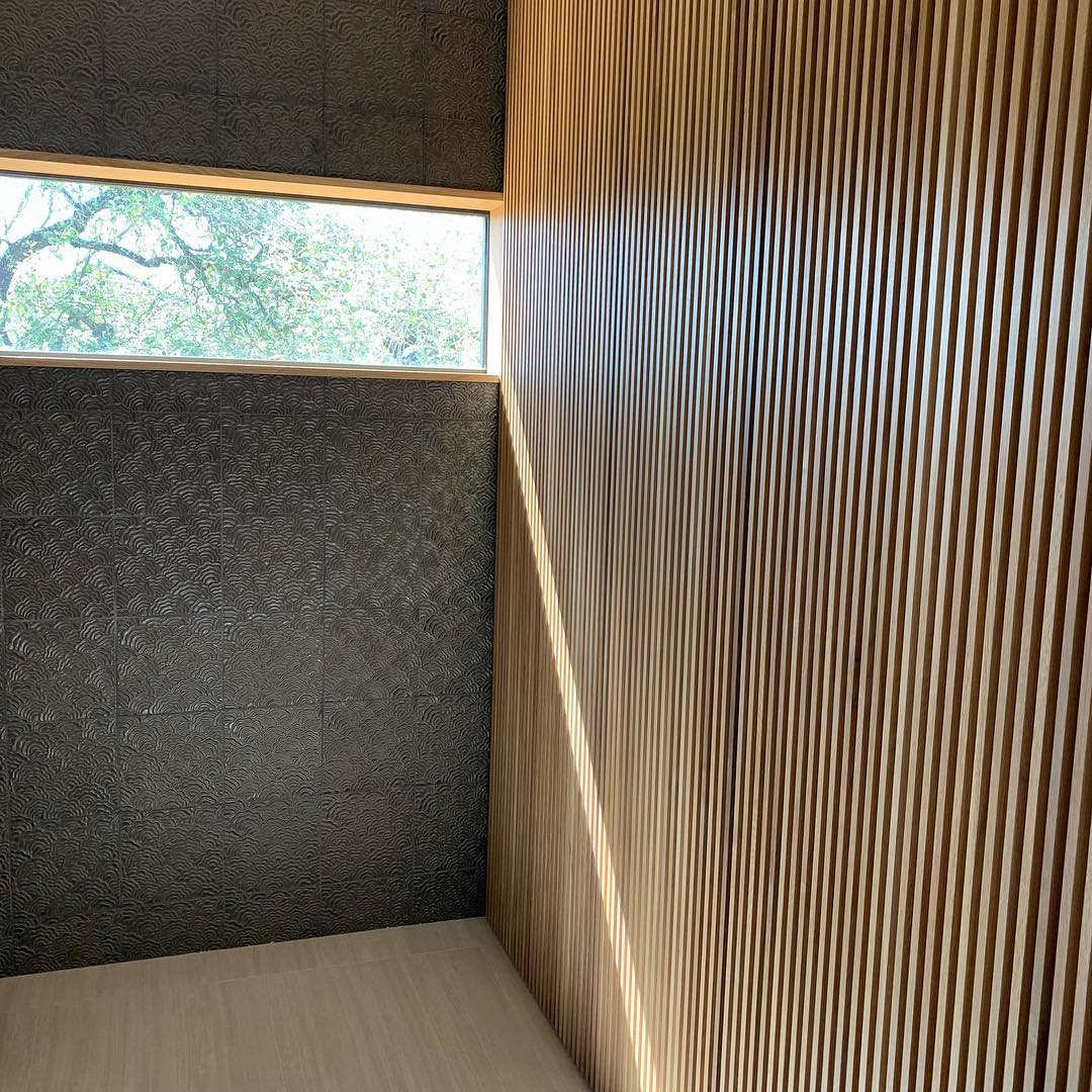 And the slat wall continues into the bathroom. Designed by @dc_architecture Built by @flitchatx and @foursquarebuilders