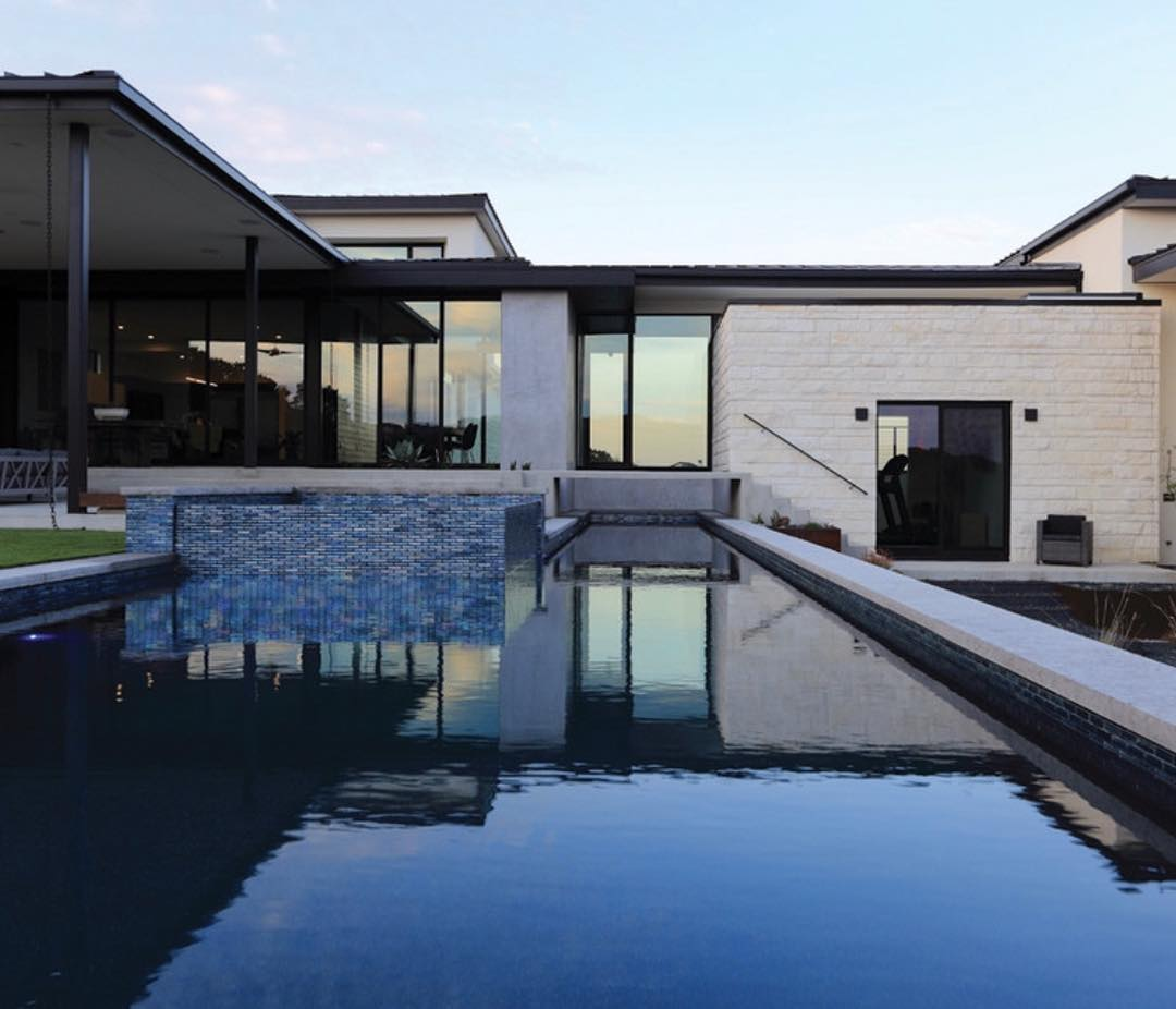 75' lap pool is the center piece of this @lankerani_architecture home.