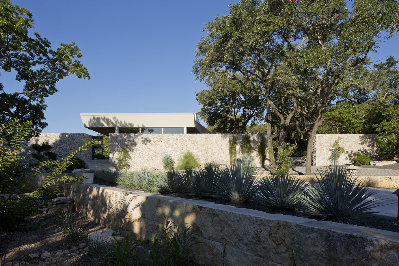 Locally sourced limestone block and stone provide structure and privacy for this estate.