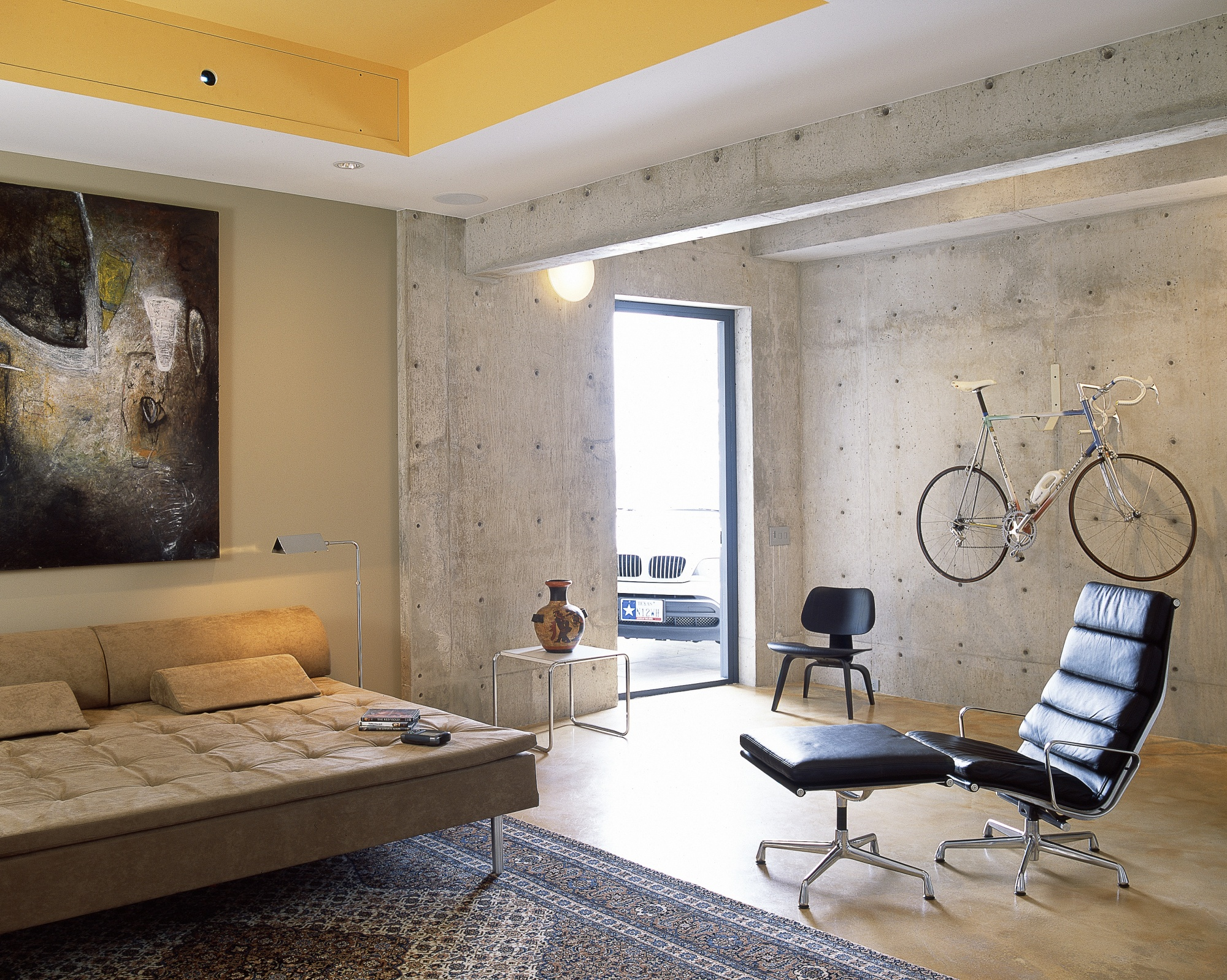 Concrete volume provides strength to this relaxing space.