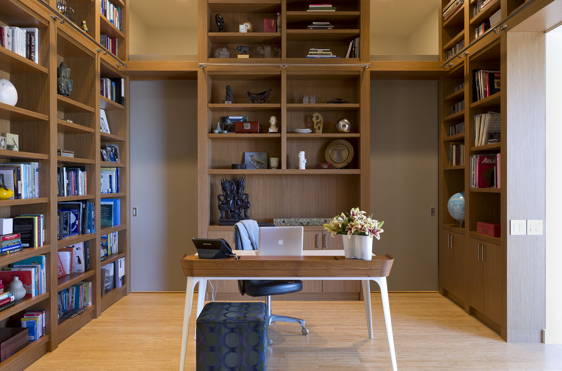 The owner's library also serves as a transition space into the master suite.