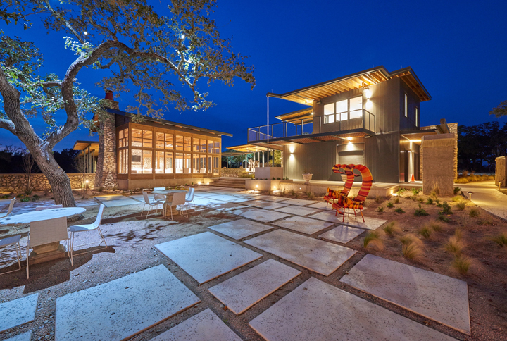 Evening outdoor dining and lounging are available within this patio.