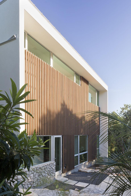 Douglas fir slat walls provide texture to this modern home.
