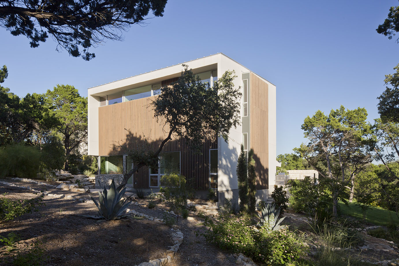 Two story volumes are wrapped in stucco, glass, and doug fir.