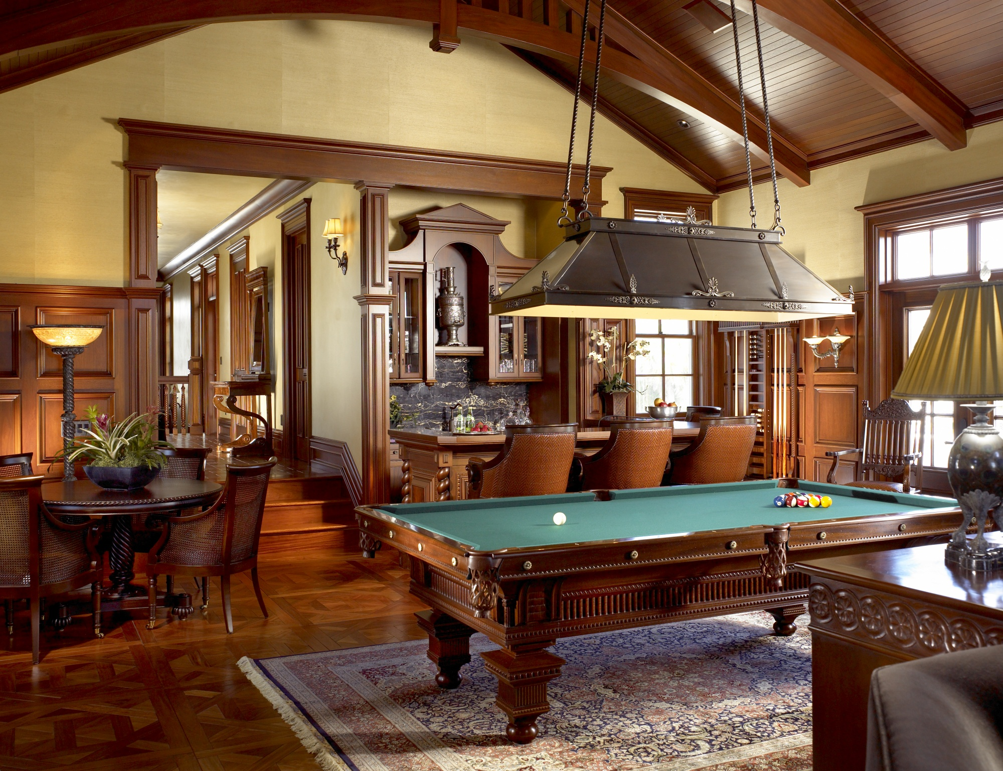 1890's pool table is featured in the adults playroom.