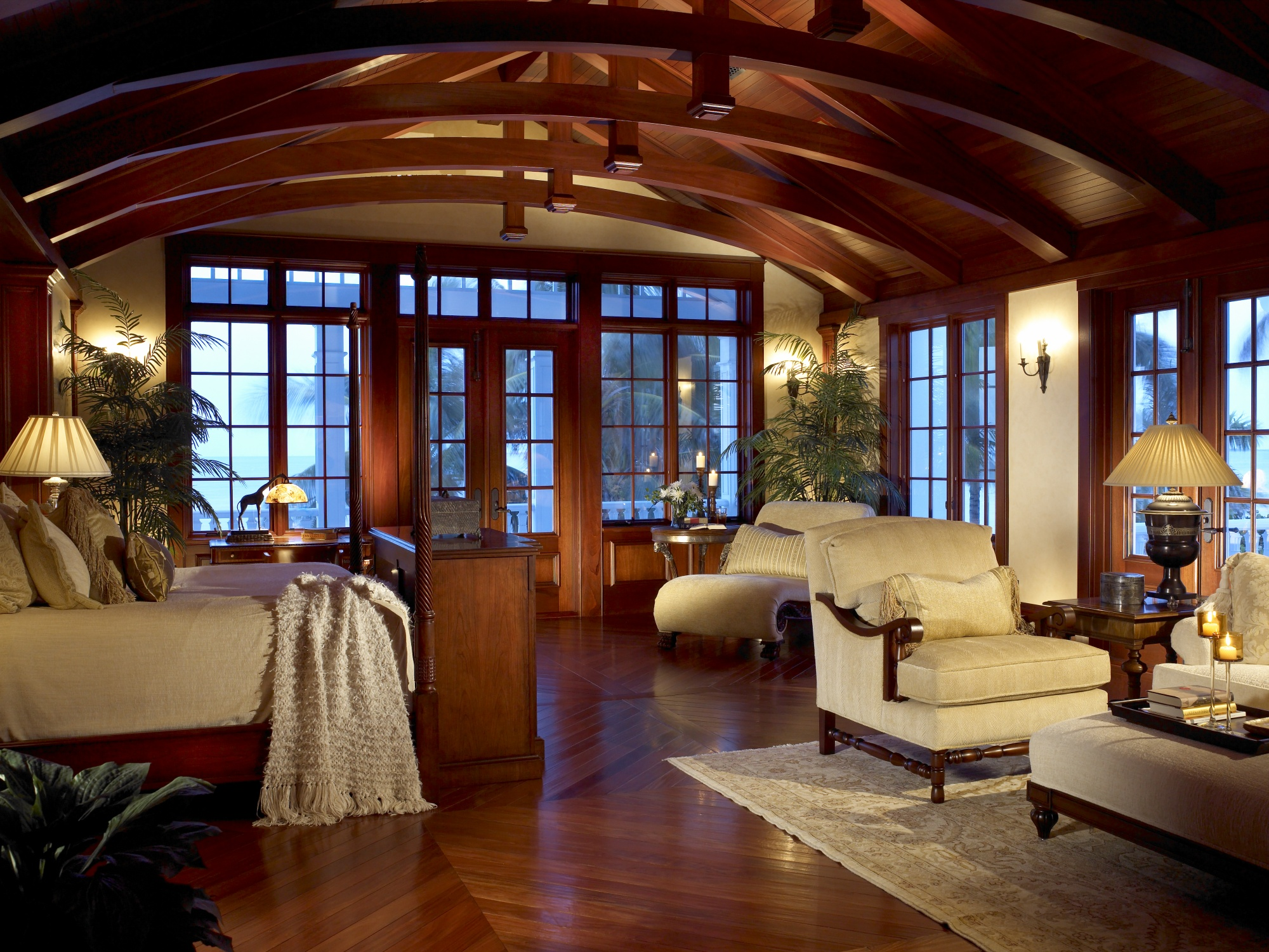 Exposed mahogany beams and venetian plaster walls are featured in the master bedroom.