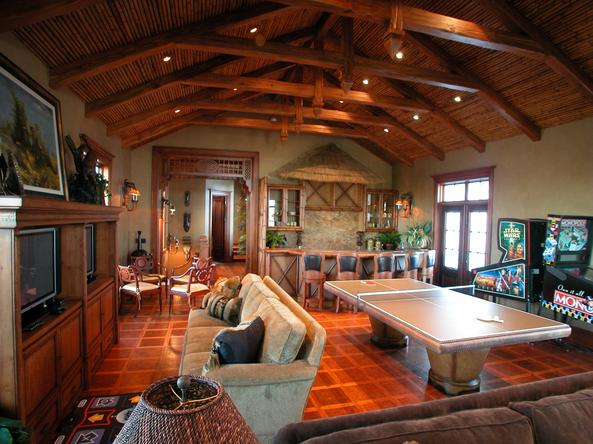 The children's playroom features hand carved pine beams.