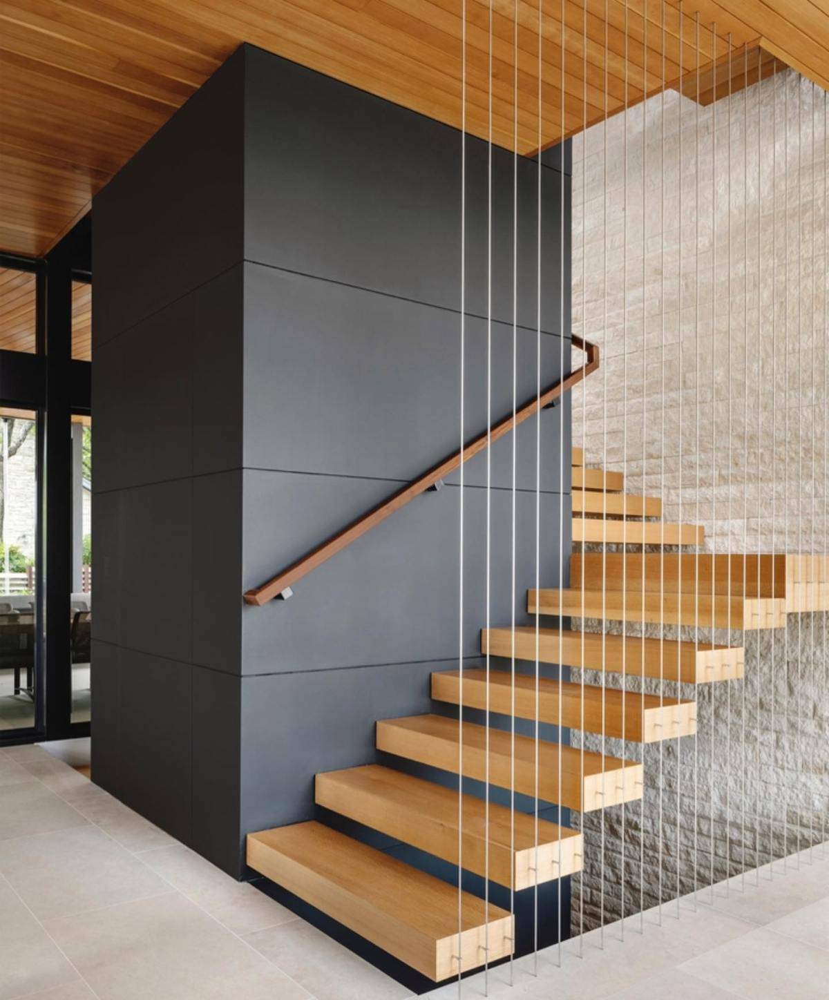 Cantilevered stair treads appear so simple and light. Honestly it takes tons of steel to make it happen.