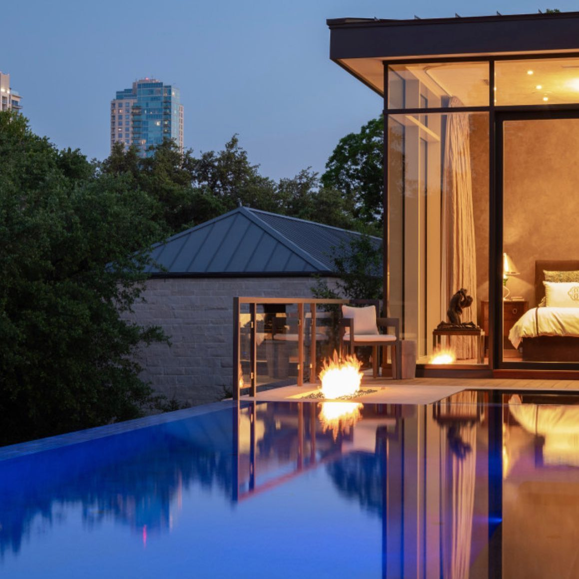 Evening view from our Old West Austin pool! Architecture by @laruearchitects pool by @austinwaterdesigns interiors by @lovecounty and most importantly thank you to our special homeowners that allowed us to build them such a special place.