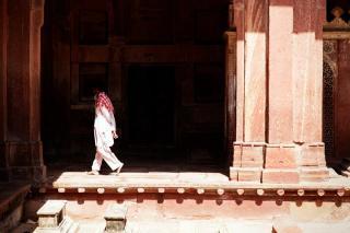 Old Man Walks Through Shadows