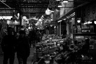 Shoppers amble through the night market in search of deals.