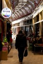 A woman walks through the market as it begins to open for the afternoon.