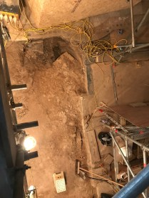 Under the tiled floor