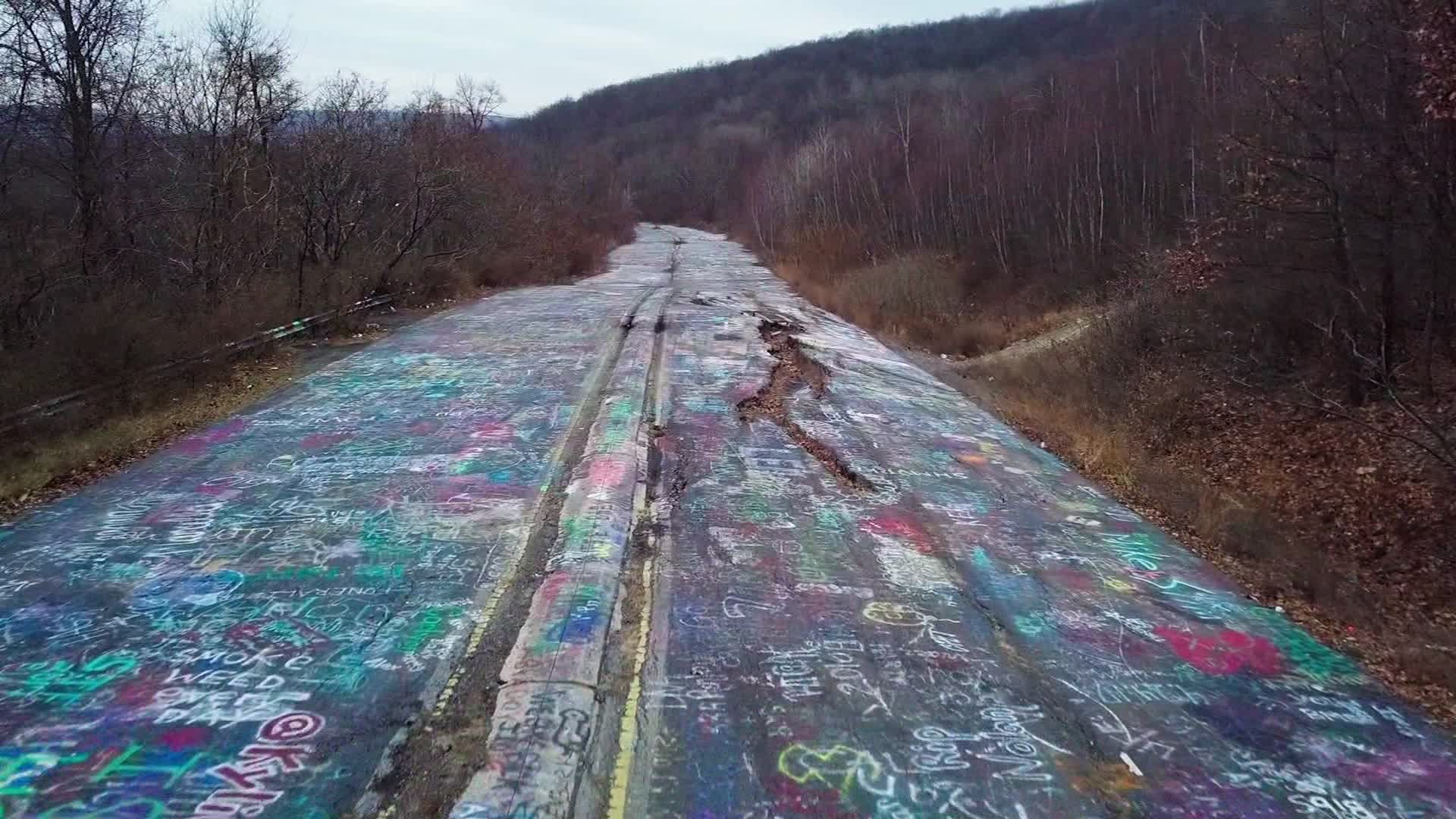 Picture of road covered in colorful graffiti