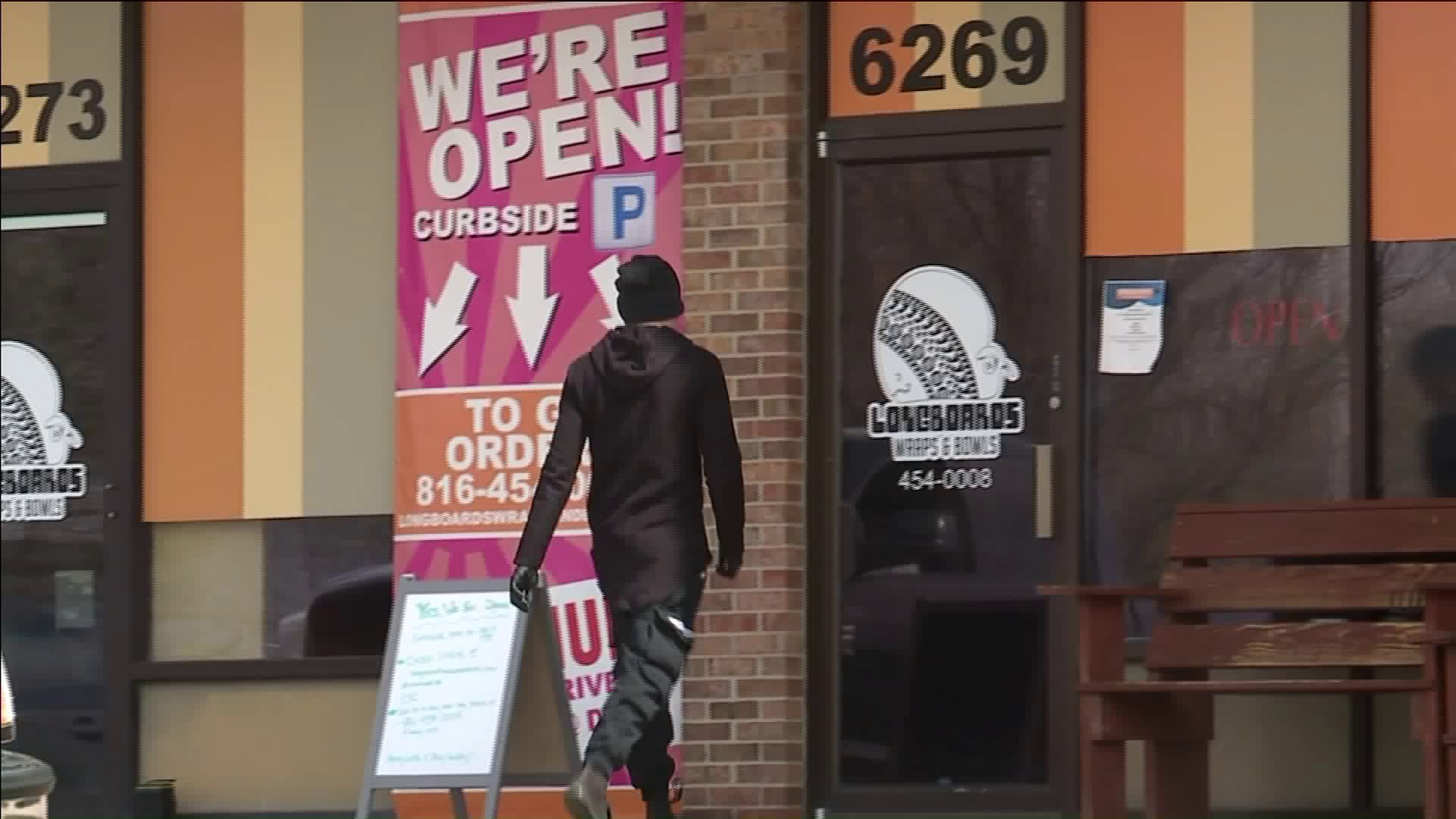 "Picture of business with ""We're open"" sign"