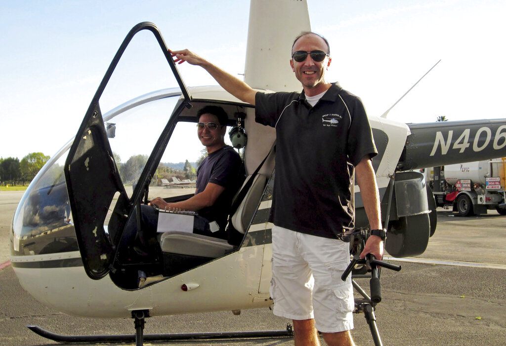 FILE - This undated file photo provided by Group 3 Aviation shows helicopter pilot Ara Zobayan standing outside a helicopter, at a location not provided. Zobayan violated federal flight rules in 2015 when he flew into busy airspace near Los Angeles International Airport despite being ordered not to by air traffic control, according to records from the Federal Aviation Administration obtained by the Los Angeles Times. (Group 3 Aviation via AP, File)