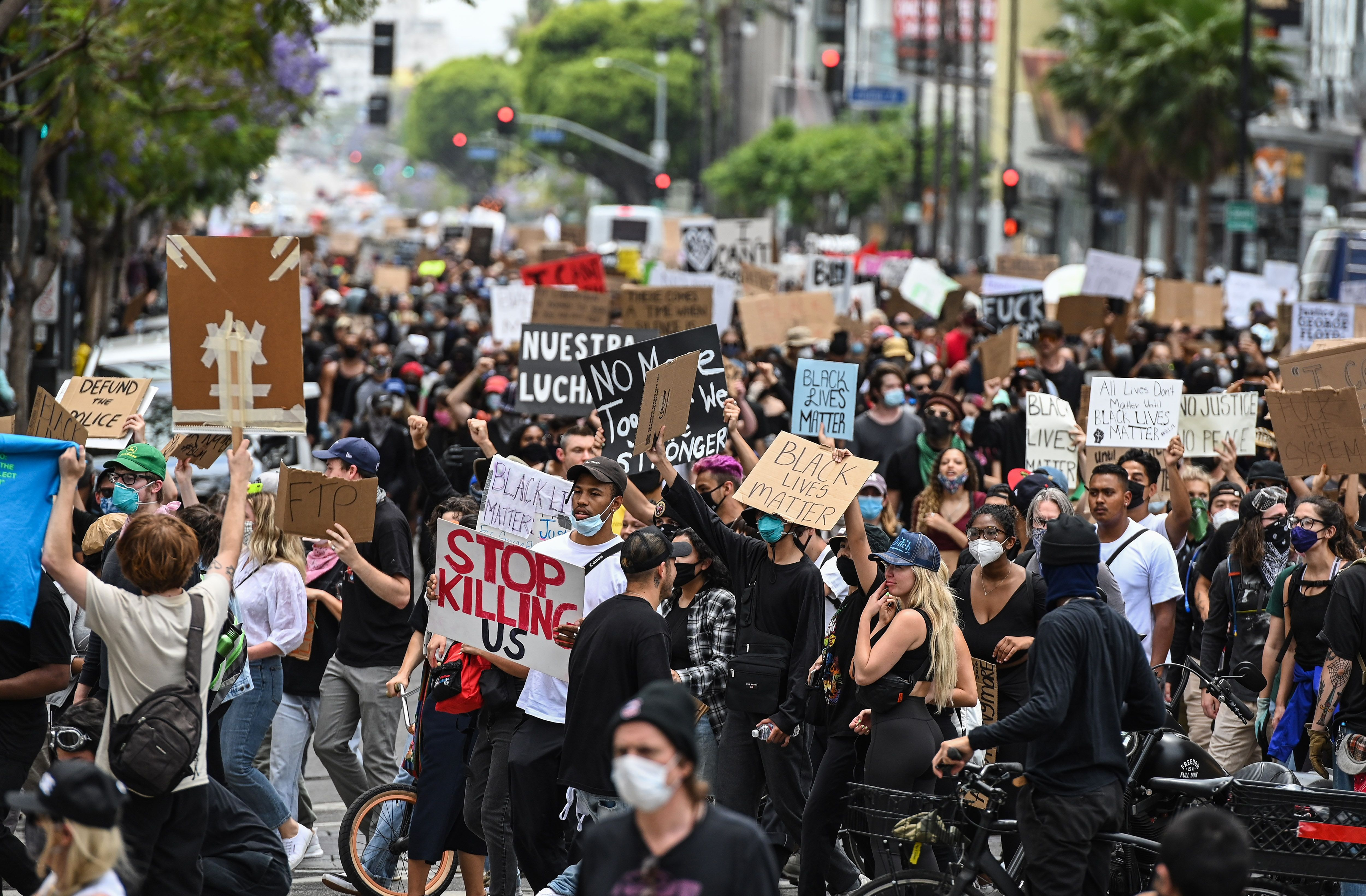 Demonstrators march through the streets of Hollywood, California